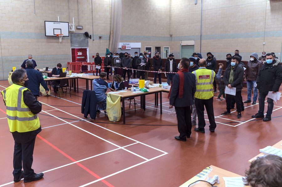 people queuing for vaccination at the Millennium Centre Gym